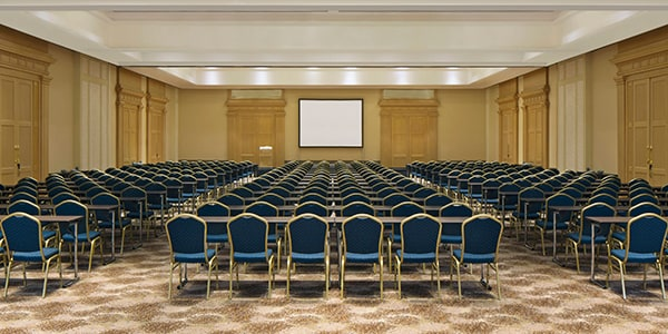 Ballroom set for a meeting with TV screen