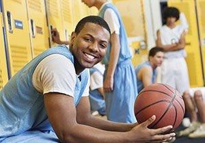 Basketball team in locker room.