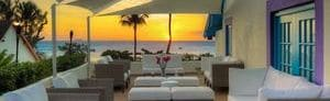 Sunset Deck at dusk boasting an ocean view and casual sofa seating