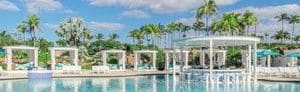 Outdoor pool with private cabanas and swim up bar.