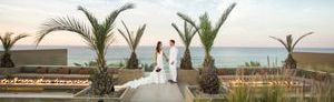 Bride and groom in an outdoor wedding setup with ocean views