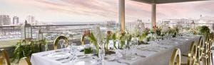 Corner event space featuring private wedding setup and skyline views of San Juan Bay