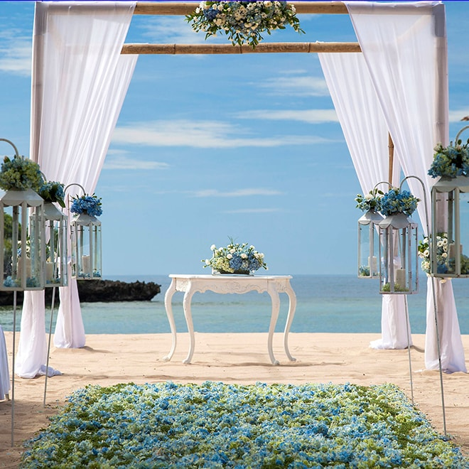 An altar and flower arrangements, overlooking the ocean
