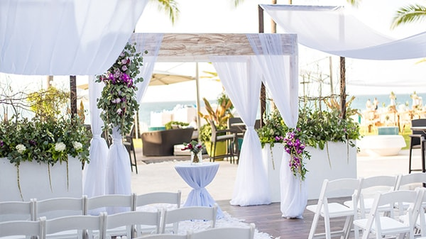 Outdoor beach wedding setup with altar