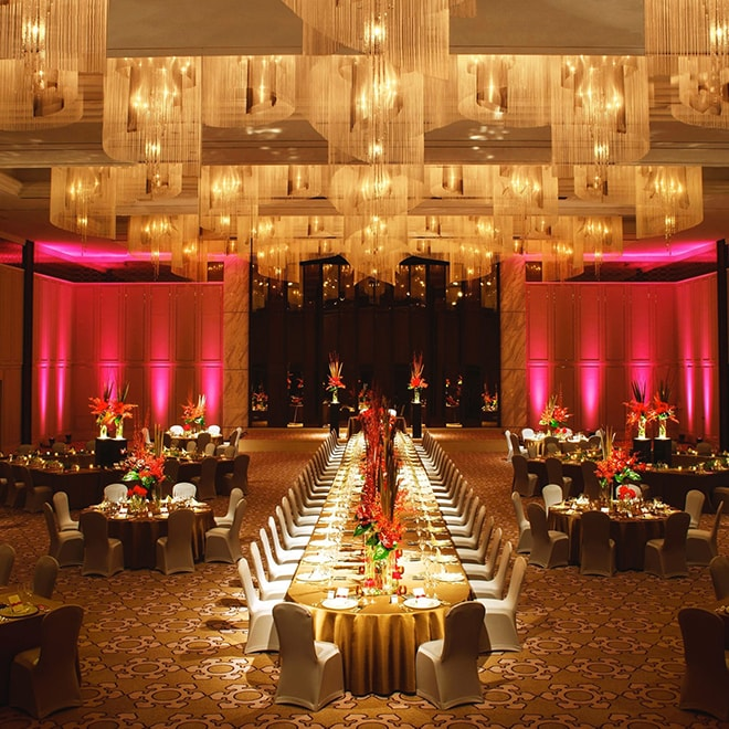 Dramatically lit, room length banquet table