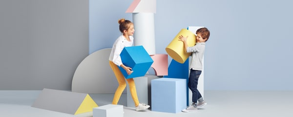 Children playing with oversized blocks