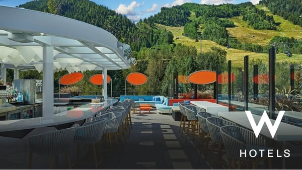 Outdoor bar and seating areas with view of mountain range
