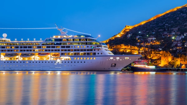 Cruise ship with bright lights sailing on the water