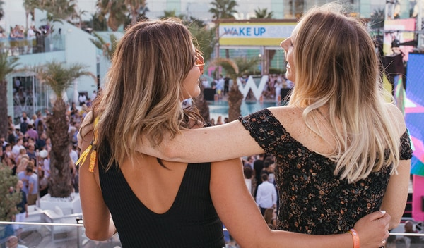 Two female friends at W Hotel outdoor music festival.