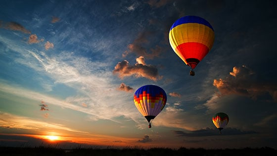 Hot air balloons in the dusk sky
