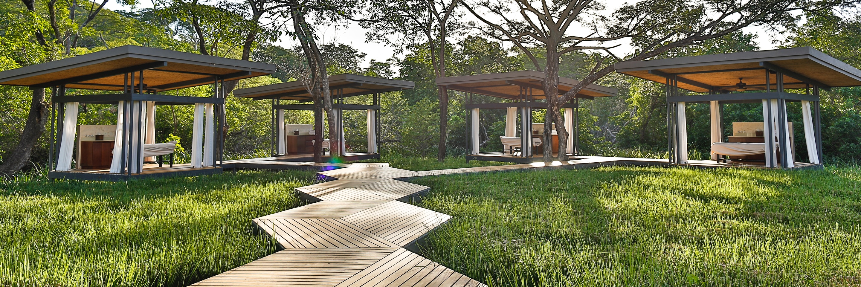 Spa cabanas at the edge of the forest