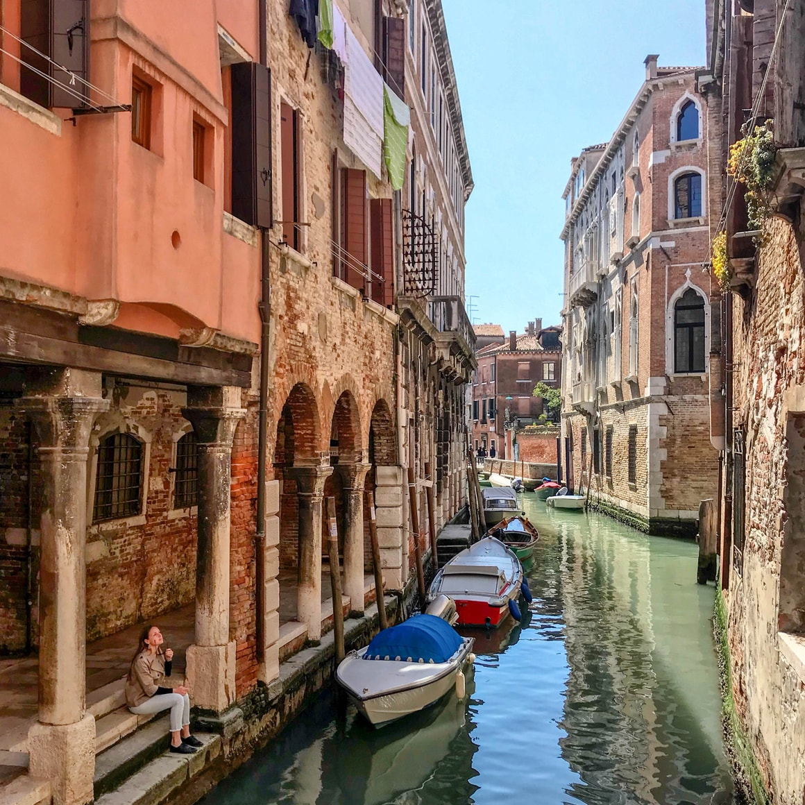 Small boats docked in a canal in Venice, Italy