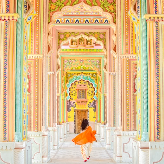 Woman walking through ornate site in Jaipur, India