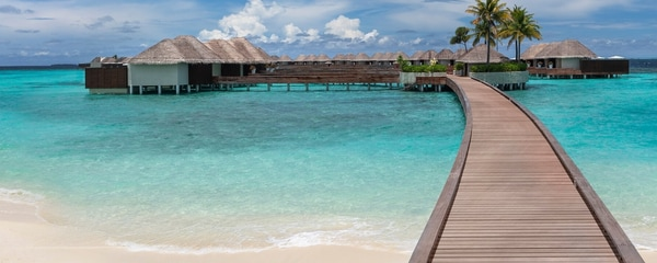 Beach overlooking overwater guesthouses