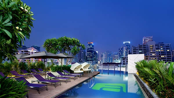 Pool deck overlooking Bangkok at night