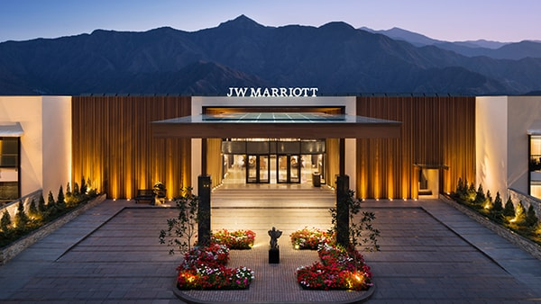 Entrance of JW Marriott with mountain in the background.