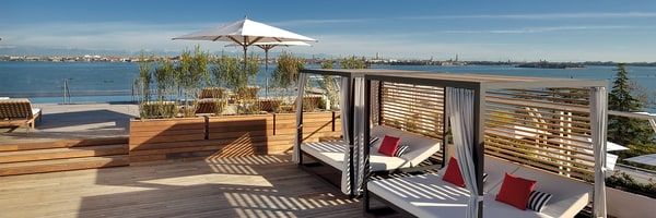 Rooftop cabana overlooking water near Venice