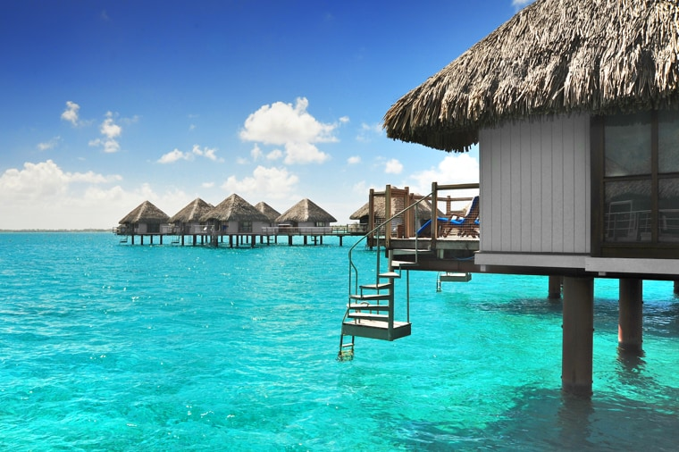 Villas set int he water at Bora Bora