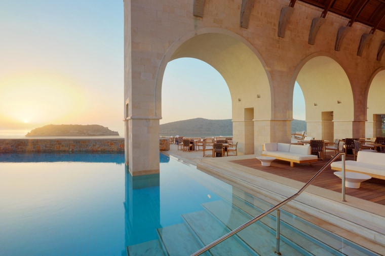 Pool lounge with stone archways
