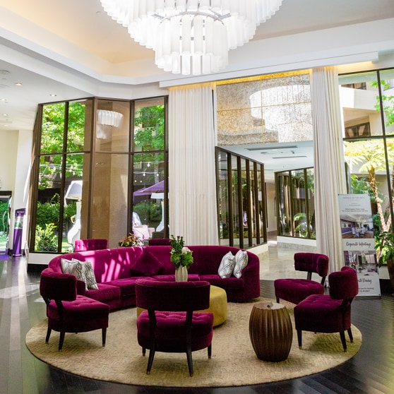 Chairs arranged in a circle in spacious hotel lobby