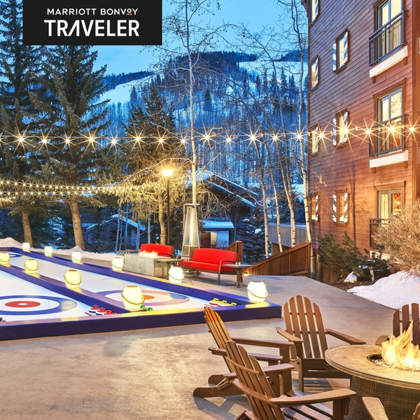 Patio with games in the mountains and Marriott Bonvoy Traveler logo