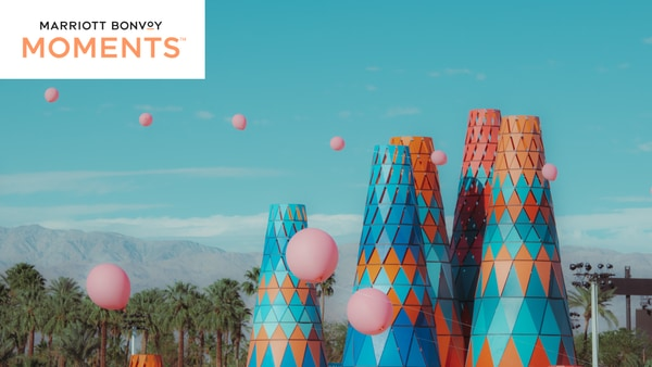 Festival art and baloons at Coachella; Marriott Bonvoy Moments logo