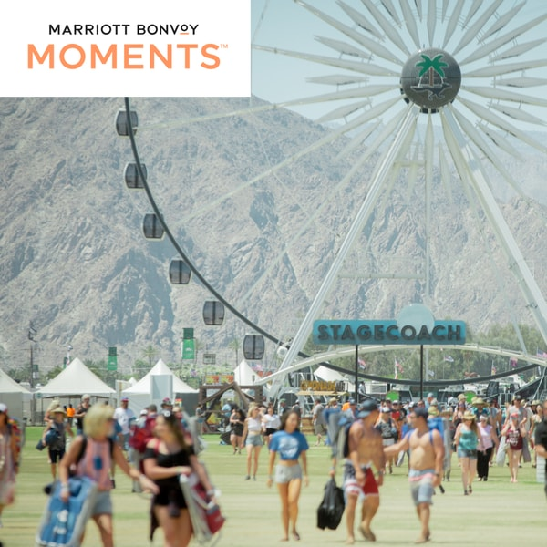 People walking at Stagecoach Festival next to a Ferris Wheel. Marriott Bonvoy Moments logo.