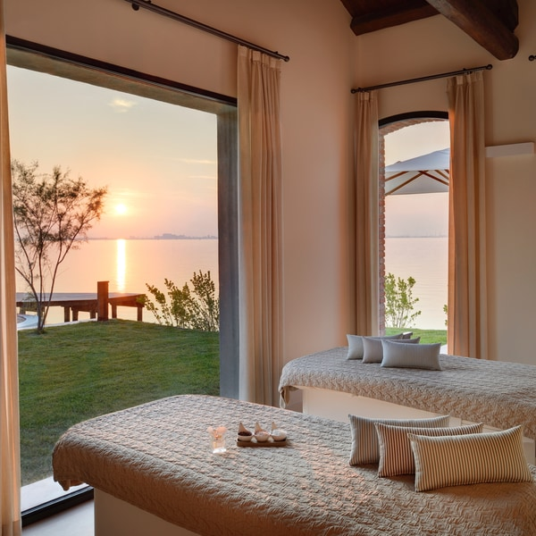Massage table looking out at sunset over the water