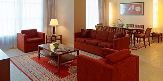 Suite with dining room, sofa and chairs