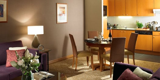 Suite with kitchen, dining table and chairs
