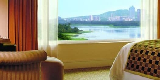 Bedroom with water and skyline view
