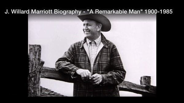 J. Willard Marriott leaning against a wooden fence at ranch.