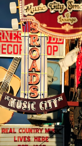 A selection of bright light-up signs for music city on display in Nashville, TN.