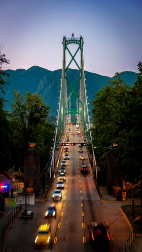 Traffic drives over The Lions Gate Bridge in Vancouver.