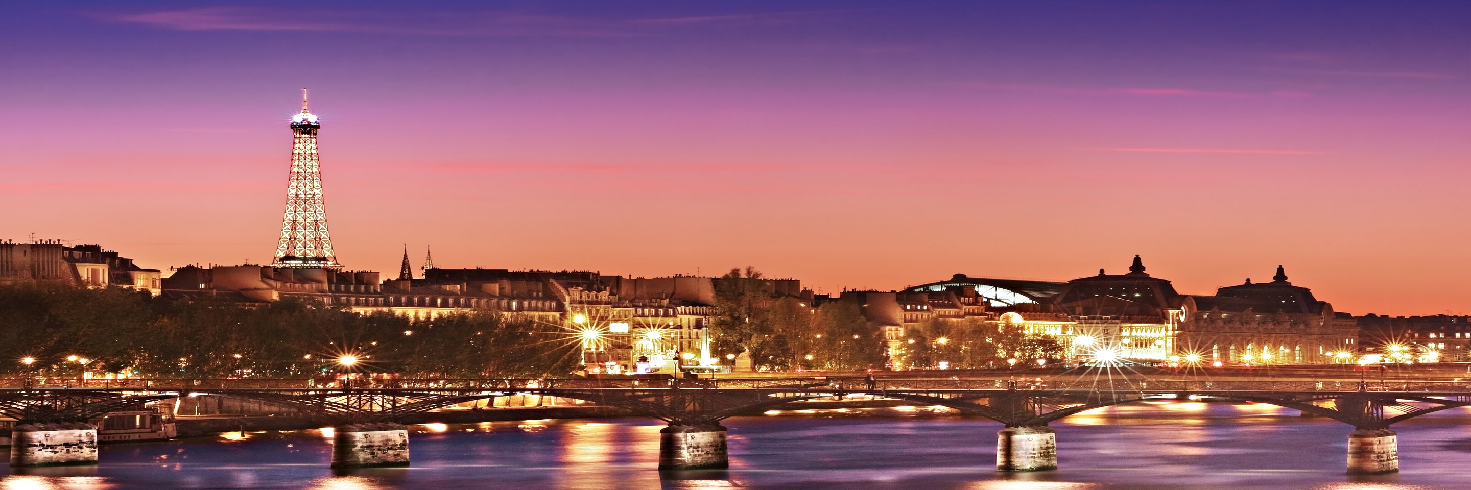 Evening view of Paris, with River Seine and the Eiffel Tower.
