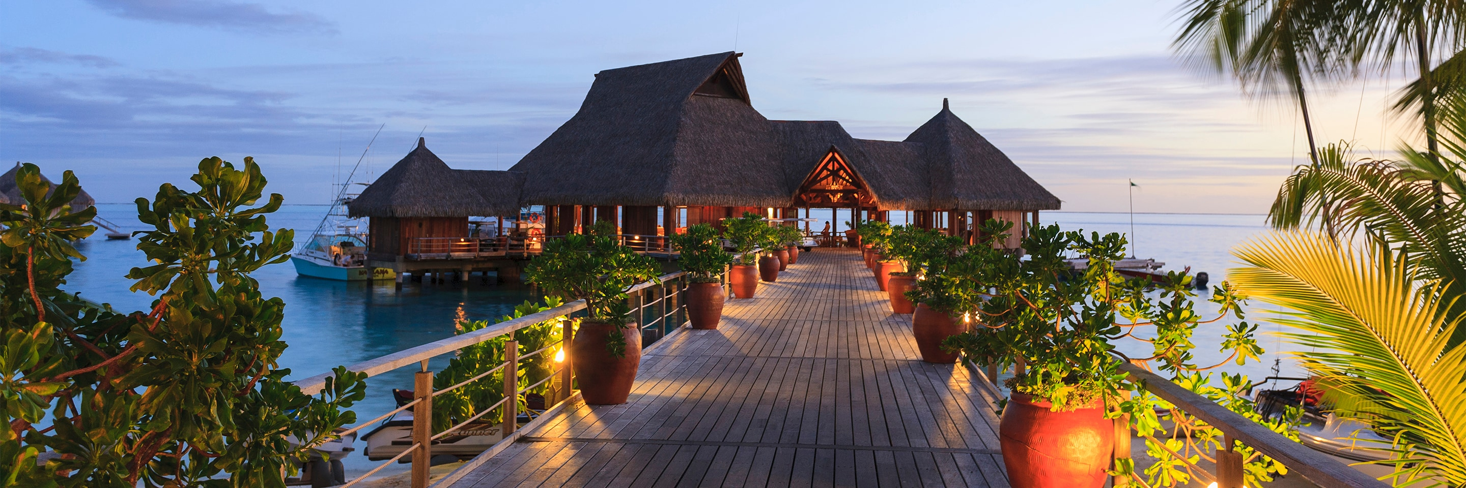 Luxury hotel and restaurant situated on a tropical ocean.