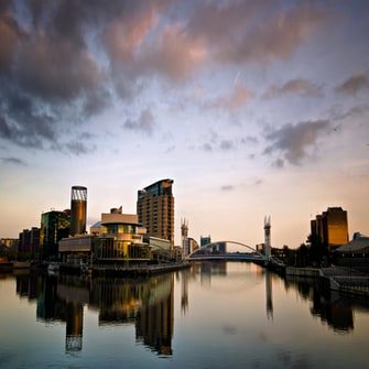 View of Manchester skyline across the river at dusk