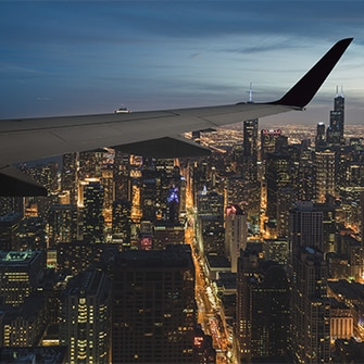 Airplane flying over the Chicago skyline.