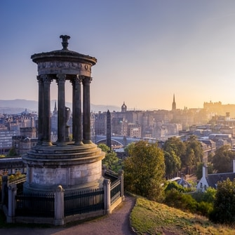 A view of historic Edinburgh from the top of Calton Hill, with Edinburgh Castle visible.