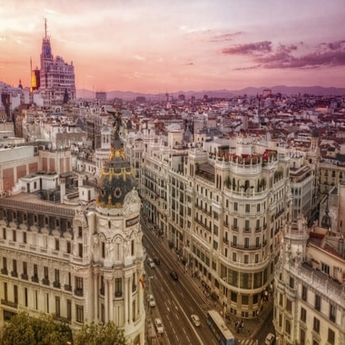Pink evening light bathes the city of Madrid.