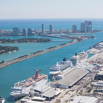 Aerial view of Miami cruise ports and nearby hotels and skyscrapers.