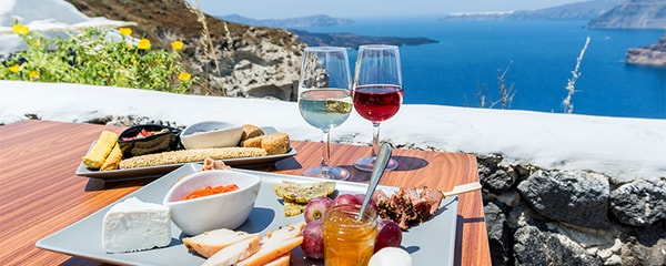 Greek food and wine with a view on the water.