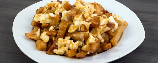 Quebec's famous poutine meal served with French fries, gravy and cheese curds.