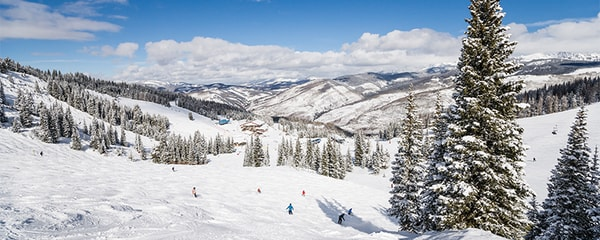 Skiing adventure on Rocky Mountains in Vail, Colorado.