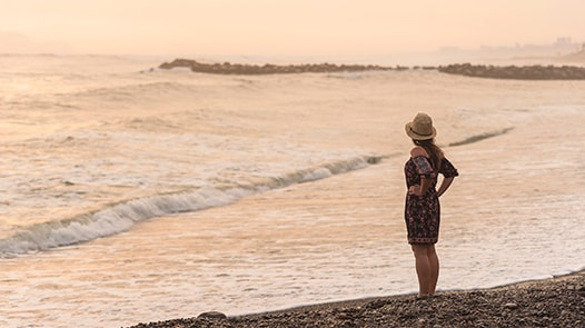 Woman looking out into the ocean in Peru