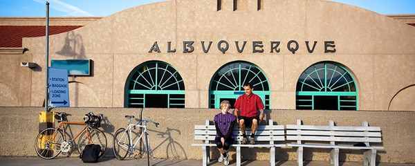 Couple sits on a bench in downtown Albuquerque, New Mexico