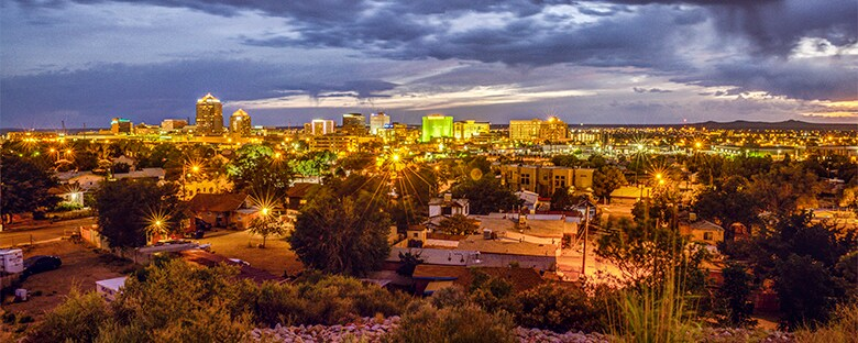 Full view of the Albuquerque skyline in New Mexico under a cloudy sky.