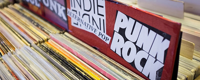 Close up view of punk rock records in a bin for sale at a store in Athens, GA.