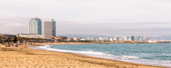 View of the ocean and Barcelona Skyline from the beach.