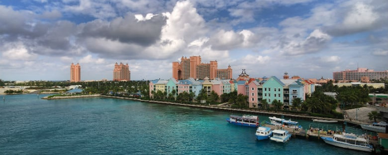 View of Bahamas shoreline with colorful buildings.